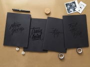 Never Give Up Black Notebook